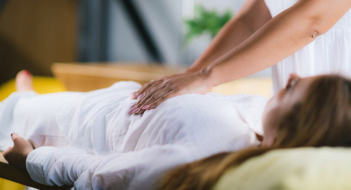 woman laying on her back receiving massage as part of the holistic approach