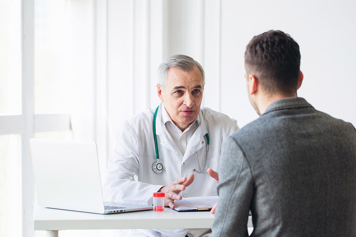 man and doctor discuss how to get off opiates
