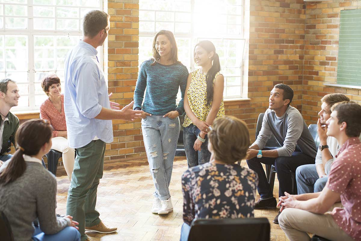 a group discusses experiential therapy